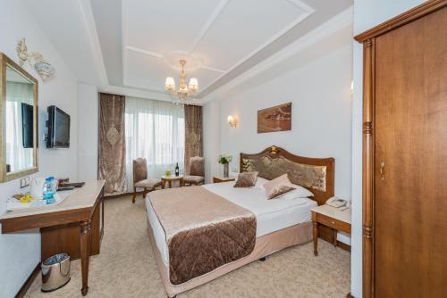 Ліжко або ліжка в номері Antis Hotel-Special Category