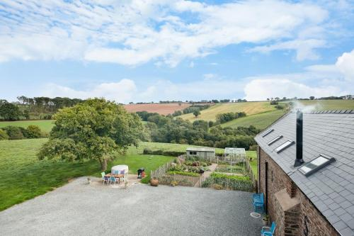 NEW Barn Conversion. Idyllic and unspoiled views complete with Hot Tub and Fire