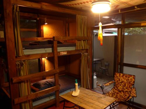 A bunk bed or bunk beds in a room at Hostel Oomori Souko