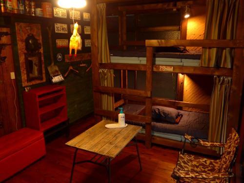 The lounge or bar area at Hostel Oomori Souko