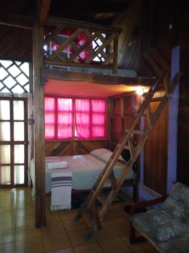 A bunk bed or bunk beds in a room at Casa Natural Puerto Viejo