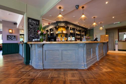 The lounge or bar area at Worplesdon Place Hotel