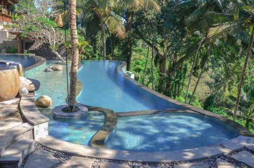 The swimming pool at or near Bucu View Resort by Pramana