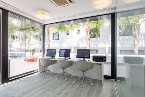 The business area and/or conference room at Migjorn Ibiza Suites & Spa