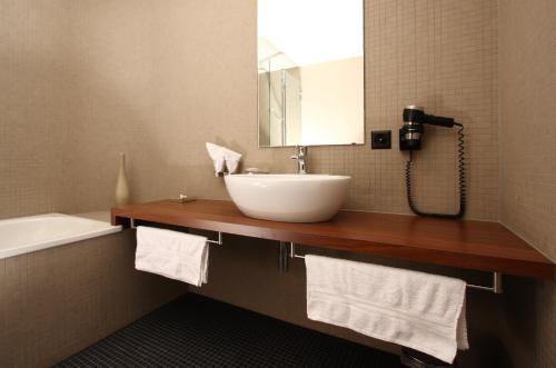 Ein Badezimmer in der Unterkunft Seehotel Gotthard