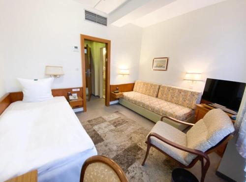 Ein Zimmer in der Unterkunft Hotel am Rathaus