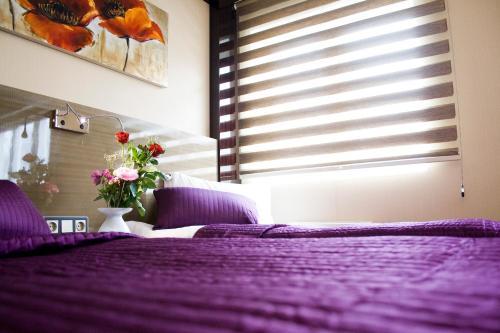 Säng eller sängar i ett rum på Hotell Angora