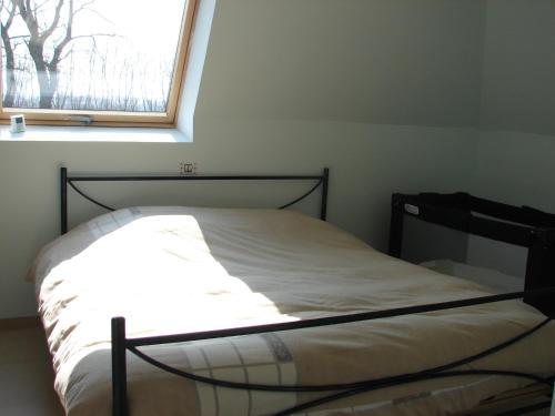 Een bed of bedden in een kamer bij Klavertje 4