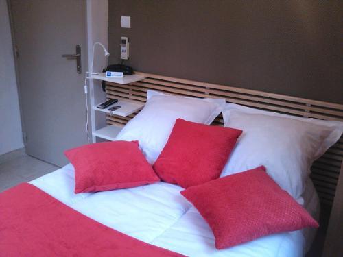 Un ou plusieurs lits dans un hébergement de l'établissement Hôtel de l'Ariana