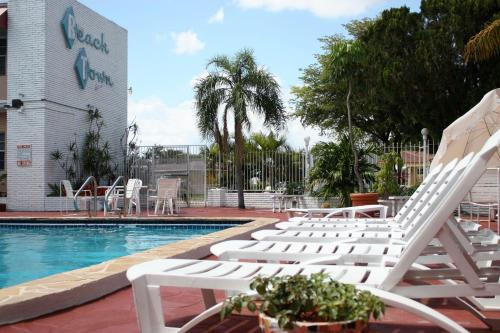 The swimming pool at or near Beach and Town Motel