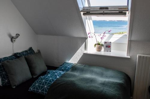 En eller flere senge i et værelse på Samsø Perlen