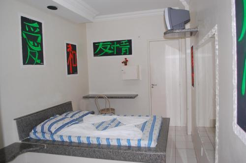 A bed or beds in a room at Hotel Piramide - Dois de Julho (Adult Only)