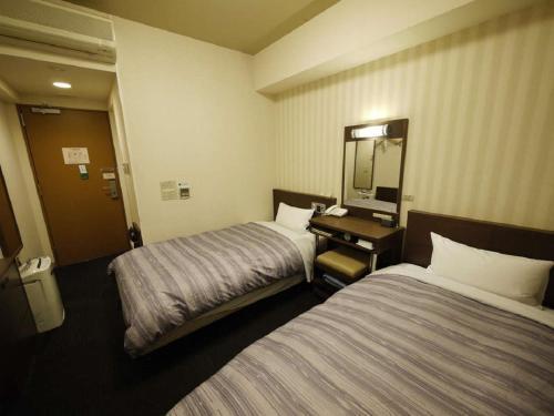 A room at Hotel Route-Inn Yokohama Bashamichi