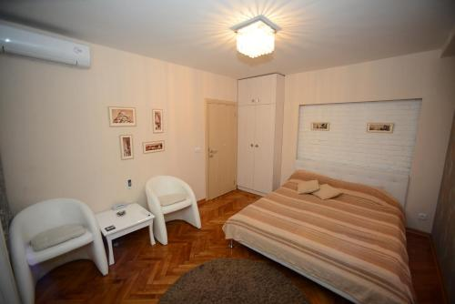A bed or beds in a room at Belgrade Central Zone Apartments