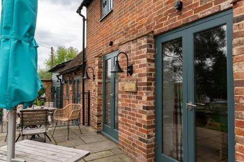 A porch or other outdoor area at The Vineyard Lamberhurst