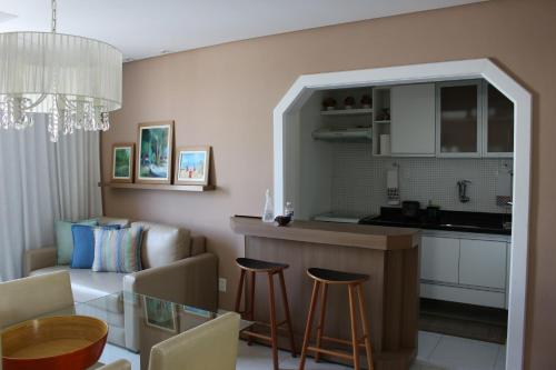 The lounge or bar area at Porto do Sol Apartment