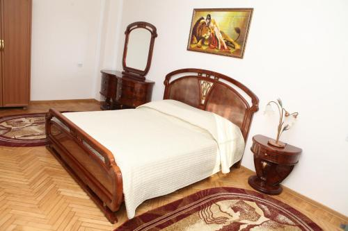 A bed or beds in a room at Planet Lux Hotel