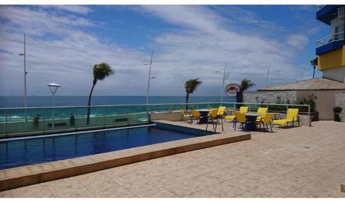 The swimming pool at or close to Ap 210 Bahia Flat, Barra