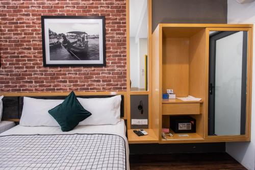 A bed or beds in a room at B Street Hotel