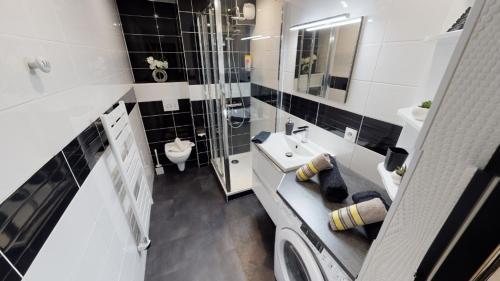 Salle de bains dans l'établissement L'Intramuros
