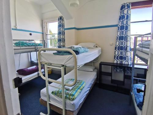 A bunk bed or bunk beds in a room at Toad Hall Accommodation