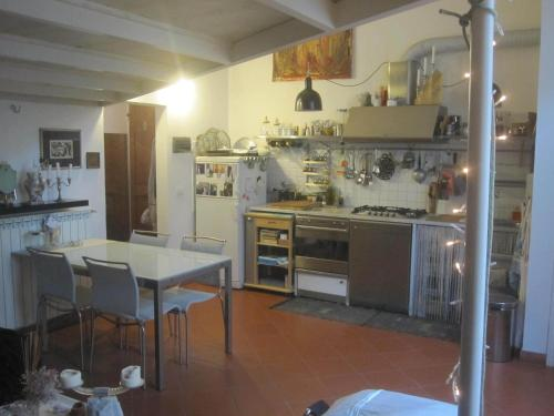 A kitchen or kitchenette at Openspace Delizioso