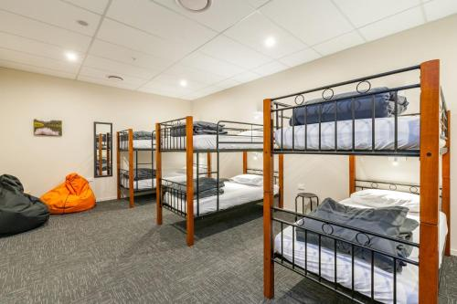 A bunk bed or bunk beds in a room at Rock Solid Backpackers Rotorua