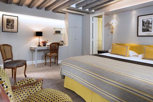 Um quarto em Le Relais Saint Honoré