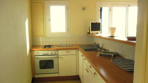A kitchen or kitchenette at Echappée Bleue Immobilier - Le Pigeonnier