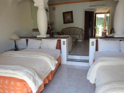Letto o letti in una camera di Gran Hotel Hacienda De La Noria