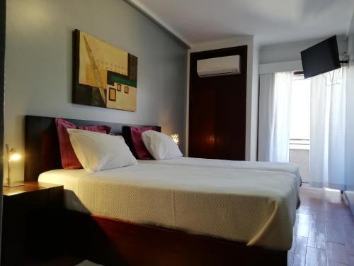 Um quarto em Hotel Dom Joao IV