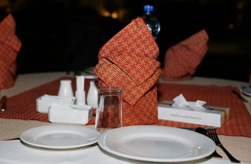 A restaurant or other place to eat at Ambassador Suites & Hotel