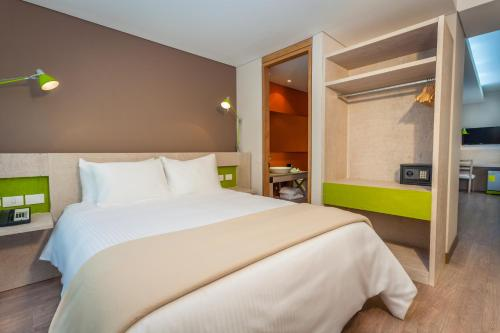 A bed or beds in a room at Mika Suites