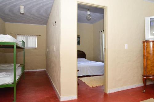 Cama o camas de una habitación en Recanto dos Manacás