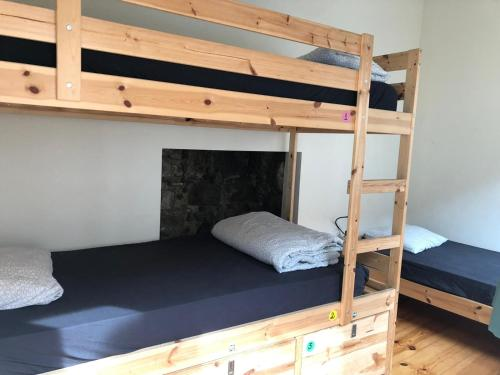 A bunk bed or bunk beds in a room at Hostel One Ribeira