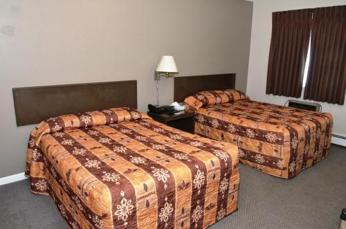 A bed or beds in a room at Blue Bell Inn