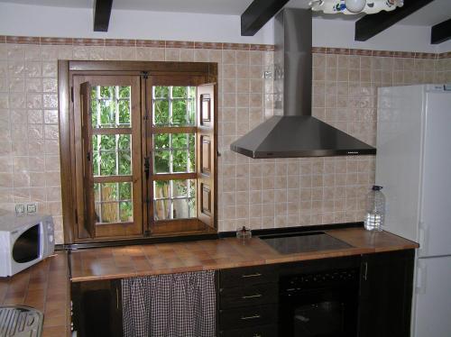 A kitchen or kitchenette at Casa Rural Tia Tomasa