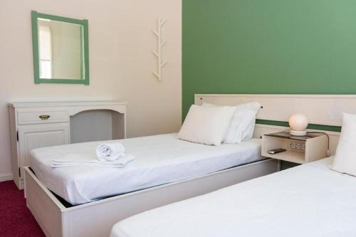 A bed or beds in a room at Arca Nova Guest House & Hostel