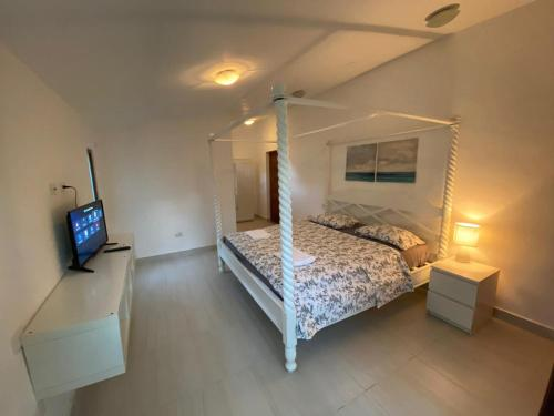A bed or beds in a room at Punta Cana Bavaro Suites Pool