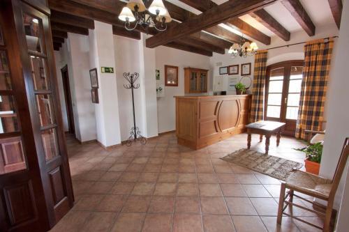The lobby or reception area at Hostal El Cortijo