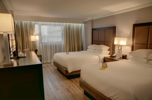 A bed or beds in a room at Crowne Plaza Hotel Knoxville, an IHG hotel