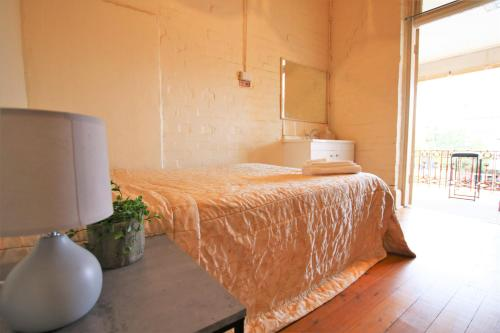 A bed or beds in a room at Imperial Moree