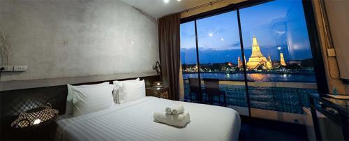 Ein Bett oder Betten in einem Zimmer der Unterkunft Inn a day