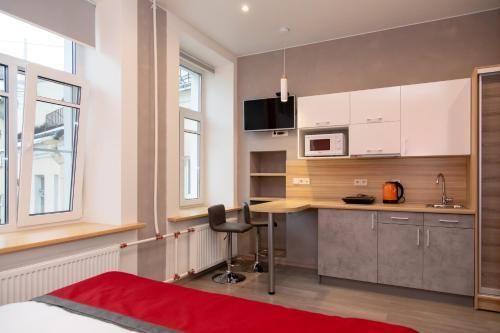 Кухня или мини-кухня в Отель Атлантика