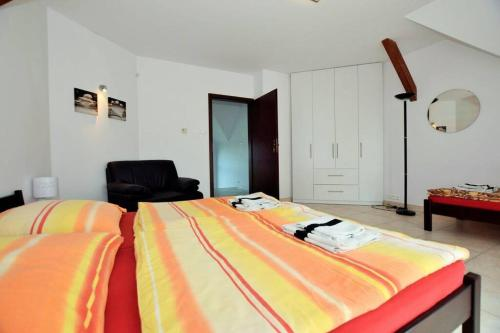 A bed or beds in a room at Dom wigierski 1