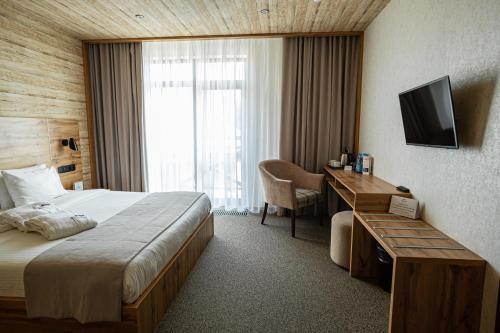 Кровать или кровати в номере Alpen Park