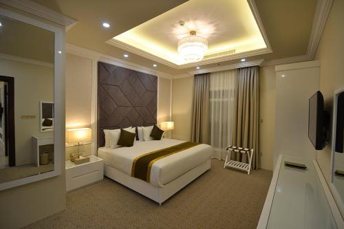 A bed or beds in a room at Remaj Hotel