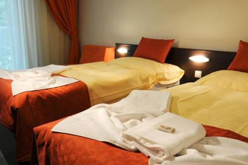 A bed or beds in a room at Hotel SOREA REGIA