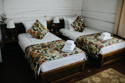 A bed or beds in a room at Boutique Hotel Marussia