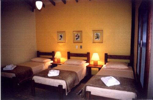 A bed or beds in a room at Hotel Fazenda Jacaúna